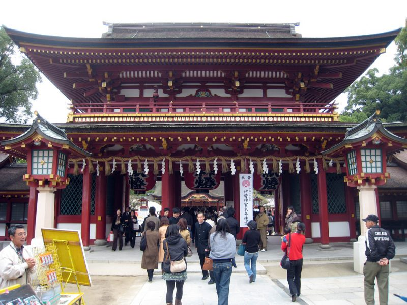 "Dazaifu Tenmangu Shrine is reached by walking along a road lined with shops selling souvenirs, sweets, and crafts, followed by a three bridges (representing the past, present and future) spanning a turtle-filled pond in the kanji for ""heart."" The shrine was established in 905, soon after the death of Sugawara Michizane, who was demoted from his position as Minister of the Right in Kyoto and exiled to Daizafu, where he continued his scholarly studies despite extreme hardship. Today, Michizane is deified as the god of literature and calligraphy, which explains why this shrine is so popular -- as the head office of 12,000 Tenmangu shrines spread throughout Japan and presided over by the 39th-generation Michizane descendant, it draws six million visitors a year, many of them high-school students praying to pass tough entrance exams into universities. Behind the main hall, which dates from 1591, hang wooden tablets, written with the wishes of visitors -- mostly for successful examination scores. Also behind the main hall is an extensive plum grove with 6,000 trees; the plum blossom, in bloom from late January to March, is considered the symbol of scholarship. -Frommers.com"